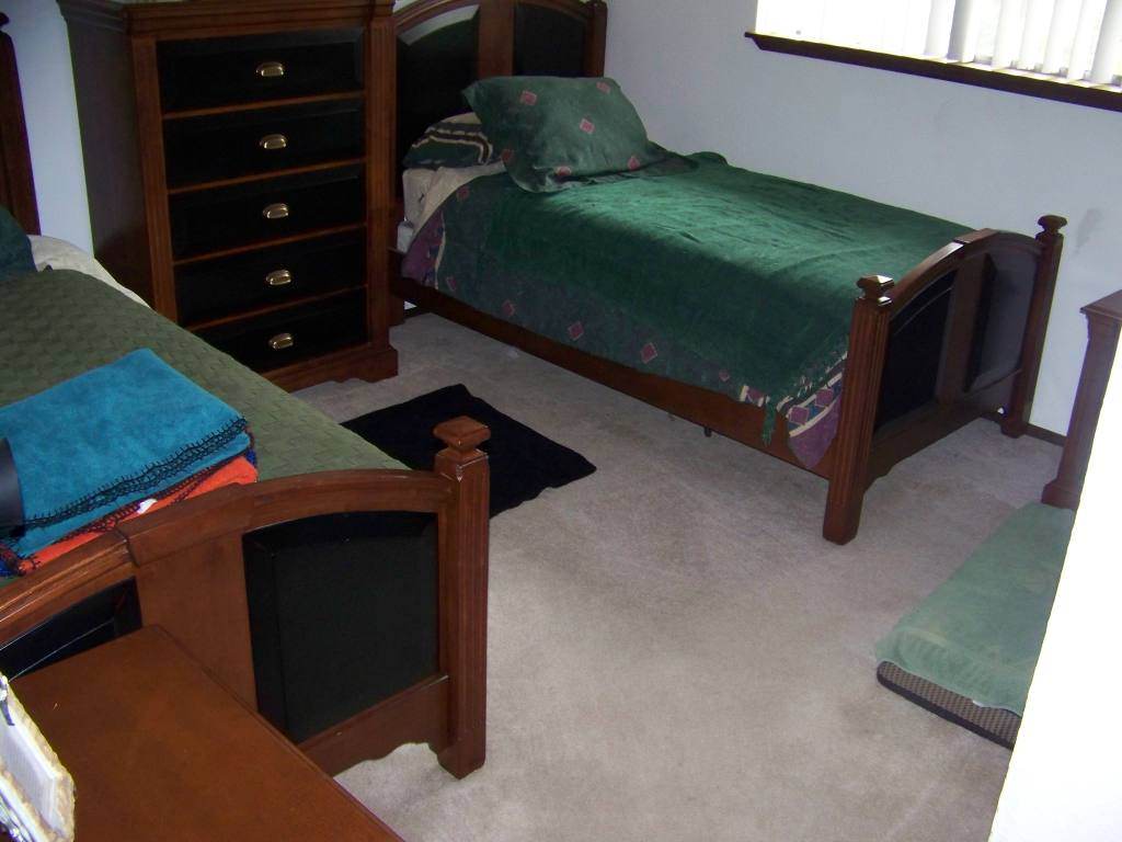 bedroom 2 has twin beds and dog beds the beds help when we need are